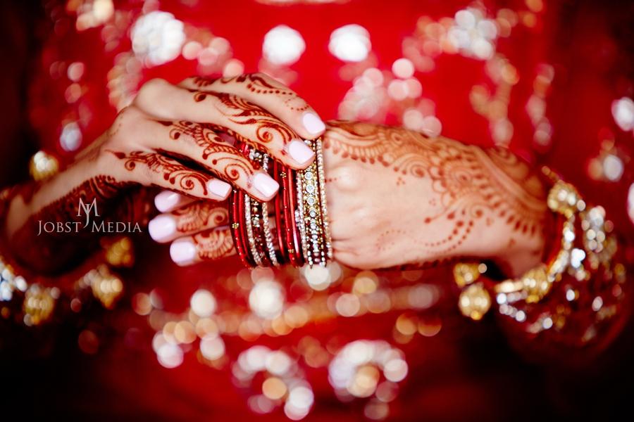 Indian Wedding Photo Shoot Chicago bride putting on bracelets